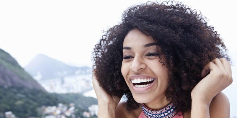 Close up portrait of happy young woman, Casa Alto Vidigal, Rio De Janeiro, Brazil